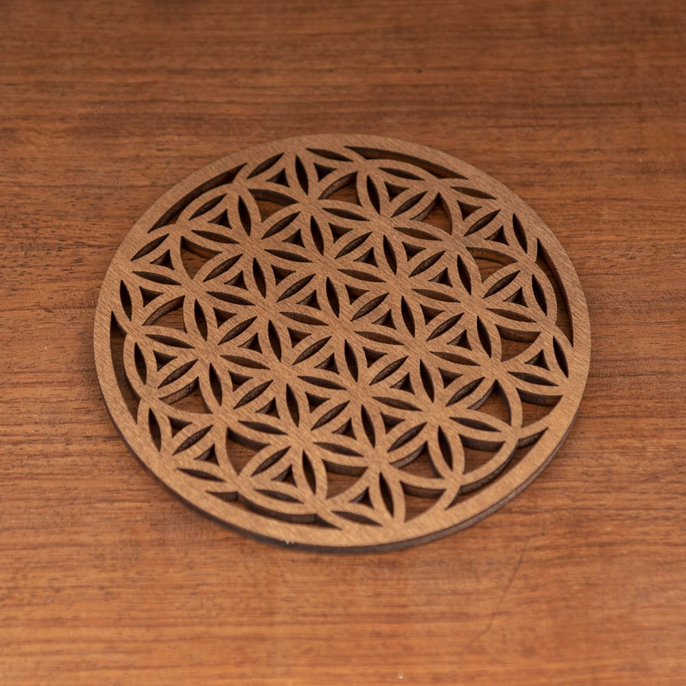 sous verre en bois motif géométrique fleur de vie